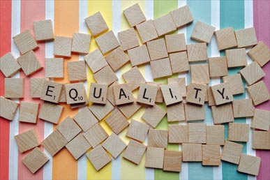 Equality headdline on a rainbow background